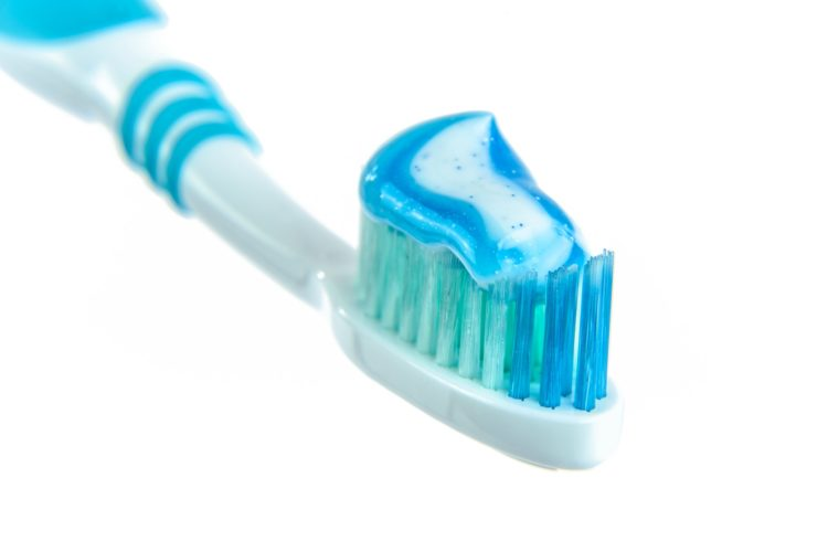 Soft bristle toothbrush and toothpaste for sensitive teeth