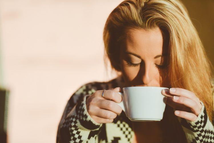 woman drinking coffee acid food tooth sensitivity